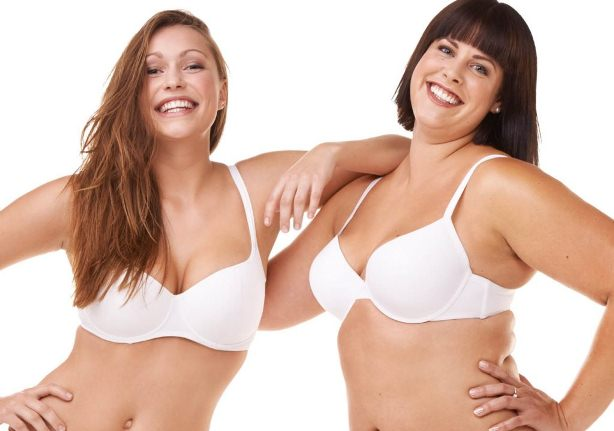 Women holding one another after a successful Breast Lift Surgery