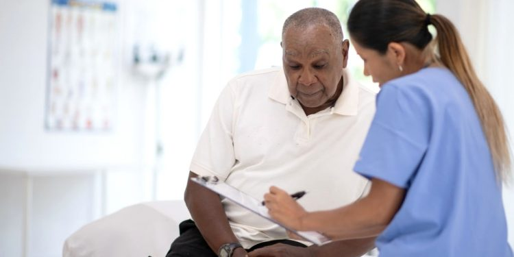 Prostate cancer old man talking to doctor